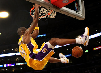 LOS ANGELES, CA - FEBRUARY 10:  Kobe Bryant #24 of the Los Angeles Lakers dunks against the Oklahoma City Thunder on February 10, 2009 at Staples Center in Los Angeles, California.   NOTE TO USER: User expressly acknowledges and agrees that, by downloadin