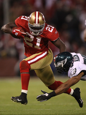 SAN FRANCISCO - OCTOBER 10:  Frank Gore #21 of the San Francisco 49ers runs against Nate Allen #29 of the Philadelphia Eagles during an NFL game at Candlestick Park on October 10, 2010 in San Francisco, California.  (Photo by Jed Jacobsohn/Getty Images)
