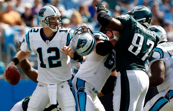 CHARLOTTE, NC - SEPTEMBER 13:  Quarterback Josh McCown #12 of the Carolina Panthers gets pressured by Brodrick Bunkley #97 of the Philadelphia Eagles during the NFL season opener at Bank of America Stadium on September 13, 2009 in Charlotte, North Carolin