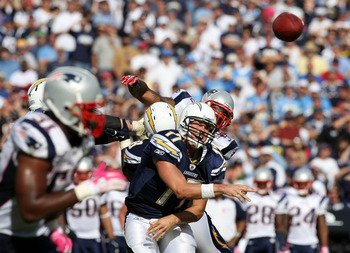 SAN DIEGO - OCTOBER 24:  Quarterback Philip Rivers #17 of the San Diego Chargers throws the ball against the pressure of the New England Patriots defense during NFL game on October 24, 2010 at Qualcomm Stadium in San Diego, California. (Photo by Donald Mi