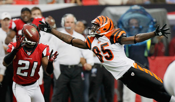 ATLANTA - OCTOBER 24:  Chirstopher Owens #21 of the Atlanta Falcons nearly picks off this pass intended for Chad Ochocinco #85 of the Cincinnati Bengals at Georgia Dome on October 24, 2010 in Atlanta, Georgia.  (Photo by Kevin C. Cox/Getty Images)
