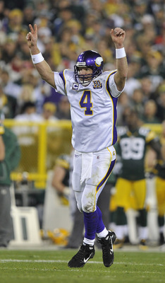 GREEN BAY, WI - OCTOBER 24:   Brett Favre #4 of the Minnesota Vikings celebrates a touchdown against the Green Bay Packers at Lambeau Field on October 24, 2010 in Green Bay, Wisconsin. (Photo by Jim Prisching/Getty Images)