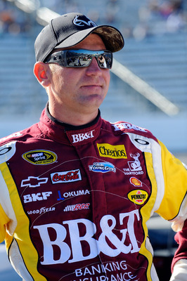 MARTINSVILLE, VA - OCTOBER 22:  Clint Bowyer, driver of the #33 BB&T Chevrolet, stands on pit road during qualifying for the NASCAR Sprint Cup Series TUMS Fast Relief 500 at Martinsville Speedway on October 22, 2010 in Martinsville, Virginia.  (Photo by J