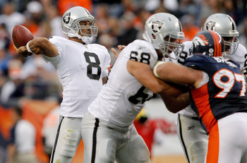 DENVER - OCTOBER 24:  Quarterback Jason Campbell #8 of the Oakland Raiders makes a pass against the Denver Broncos in the third quarter at INVESCO Field at Mile High on October 24, 2010 in Denver, Colorado. The Raiders defeated the Broncos 59-14. (Photo b