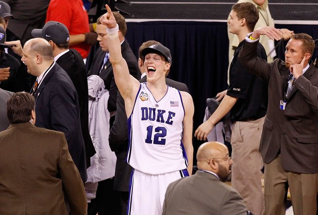 INDIANAPOLIS - APRIL 05:  Kyle Singler #12 of the Duke Blue Devils celebrates after Duke won 61-59 against the Butler Bulldogs during the 2010 NCAA Division I Men's Basketball National Championship game at Lucas Oil Stadium on April 5, 2010 in Indianapoli