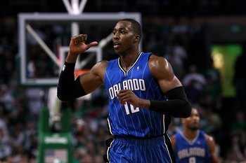 BOSTON - MAY 28:  Dwight Howard #12 of the Orlando Magic gestures as he runs up court against the Boston Celtics in Game Six of the Eastern Conference Finals during the 2010 NBA Playoffs at TD Garden on May 28, 2010 in Boston, Massachusetts.  NOTE TO USER