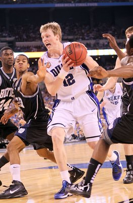 INDIANAPOLIS - APRIL 05:  Kyle Singler #12 of the Duke Blue Devils drives against the Butler Bulldogs during the 2010 NCAA Division I Men's Basketball National Championship game at Lucas Oil Stadium on April 5, 2010 in Indianapolis, Indiana.  (Photo by An