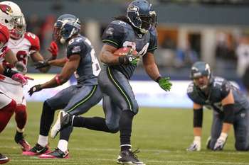 SEATTLE - OCTOBER 24:  Running back Marshawn Lynch #24 of the Seattle Seahawks rushes against the Arizona Cardinals at Qwest Field on October 24, 2010 in Seattle, Washington. (Photo by Otto Greule Jr/Getty Images)