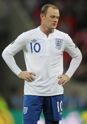 LONDON, ENGLAND - OCTOBER 12: Wayne Rooney of England looks dejected during the UEFA EURO 2012 Group G Qualifying match between England and Montenegro at Wembley Stadium on October 12, 2010 in London, England.  (Photo by Hamish Blair/Getty Images)