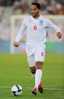 DOHA, QATAR - NOVEMBER 14: Joleon Lescott of England in action during the International Friendly match between Brazil and England at the Khalifa Stadium on November 14, 2009 in Doha, Qatar.  (Photo by Michael Regan/Getty Images)