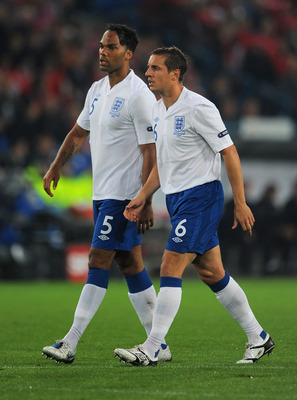 BASEL, SWITZERLAND - SEPTEMBER 07:  Joleon Lescott and Phil Jagielka of England look on during the EURO 2012 Group G Qualifier between Switzerland and England at St Jakob Park on September 7, 2010 in Basel, Switzerland.  (Photo by Michael Regan/Getty Imag