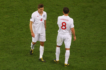 CAPE TOWN, SOUTH AFRICA - JUNE 18:  Captain Steven Gerrard and Frank Lampard of England look dejected during the 2010 FIFA World Cup South Africa Group C match between England and Algeria at Green Point Stadium on June 18, 2010 in Cape Town, South Africa.