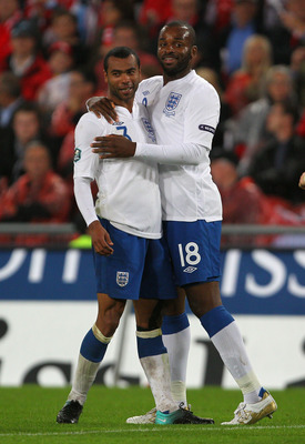 BASEL, SWITZERLAND - SEPTEMBER 07:  Darren Bent of England celebrates scoring his team's thrid goal with Ashley Cole during the EURO 2012 Group G Qualifier between Switzerland and England at St Jakob Park on September 7, 2010 in Basel, Switzerland.  (Phot