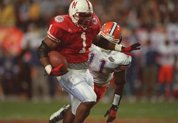 2 JAN 1996:  RUNNING BACK LAWRENCE PHILLIPS #1 OF THE NEBRASKA CORNHUSKERS AVOIDS DEFENSIVE BACK BEN HANKS #11 OF THE FLORIDA GATORS DURING THE FIESTA BOWL AT SUN DEVIL STADIUM IN TEMPE, ARIZONA.   Mandatory Credit: Mike Powell/ALLSPORT