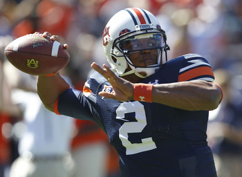 AUBURN, AL - OCTOBER 16:  Quarterback Cam Newton #2 of the Auburn Tigers throws a practice pass before the game against the Arkansas Razorbacks at Jordan-Hare Stadium on October 16, 2010 in Auburn, Alabama.  (Photo by Mike Zarrilli/Getty Images)