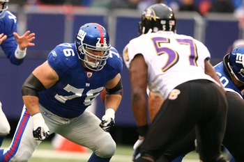 EAST RUTHERFORD, NJ - NOVEMBER 16:  Chris Snee #76 of the New York Giants blocks Bart Scott #57 of the Baltimore Ravens during their game on November 16, 2008 at Giants Stadium in East Rutherford, New Jersey.  (Photo by Al Bello/Getty Images)