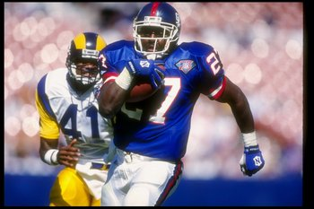 16 Oct 1994:  Running back Rodney Hampton of the New York Giants   (right) moves the ball as Los Angeles Rams defensive back Todd Lyght chases him during a game at Anaheim Stadium in Anaheim, California.  The Rams won the game, 17-10. Mandatory Credit: Al