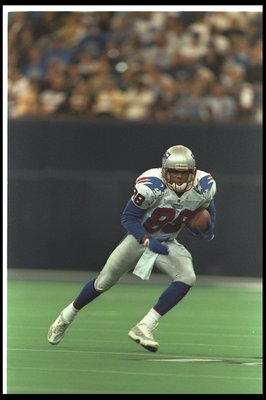 20 Oct 1996:  Wide receiver Terry Glenn of the New England Patriots moves down the field during a game against the Indianapolis Colts at the RCA Dome in Indianapolis, Indiana.  The Patriots won the game, 27-9. Mandatory Credit: Jamie Squire  /Allsport