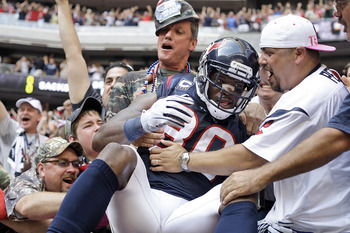 HOUSTON - OCTOBER 17:  Andre Johnson #80 of the Houston Texans is mobbed by fans after he scored the go ahead touchdown in the fourth quarter against the Kansas City Chiefs at Reliant Stadium on October 17, 2010 in Houston, Texas.  (Photo by Bob Levey/Get