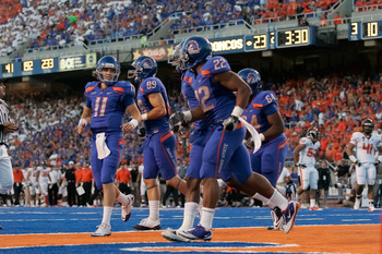 BOISE, ID - SEPTEMBER 25:  Quarterback Kellen Moore #11 and the Boise State Broncos celebrates a touchdown against the Oregon Stage Beavers at Bronco Stadium on September 25, 2010 in Boise, Idaho.  (Photo by Otto Kitsinger III/Getty Images)