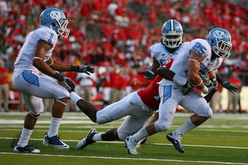 NEW BRUNSWICK, NJ - SEPTEMBER 25:  Matt Merletti #25 (R) of the North Carolina Tar Heels is tackled by Jeremy Deering #18 of the Rutgers Scarlet Knights after intercepting a pass intended for Deering in the fourth quarter at Rutgers Stadium on September 2
