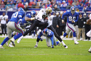 30 Sep 2001:  Willie Jackson #88 of the New Orleans Saints is tackled by Keith Hamilton #75 and Emmanuel McDaniel #26 of the New York Giants during the game at Giants Stadium in East Rutherford, New Jersey. The New York Giants win, 21-13 over the New Orle
