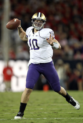 TUCSON, AZ - OCTOBER 23:  Quarterback Jake Locker #10 of the Washington Huskies scrambles to pass during the college football game against the Arizona Wildcats at Arizona Stadium on October 23, 2010 in Tucson, Arizona.  (Photo by Christian Petersen/Getty
