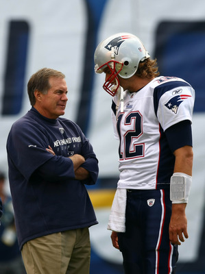 SAN DIEGO - OCTOBER 24:  Quarterback Tom Brady #12 of the New England speak to Head Coach Bill Belichick against the San Diego Chargers during their NFL game on October 24, 2010 at Qualcomm Stadium in San Diego, California. (Photo by Donald Miralle/Getty