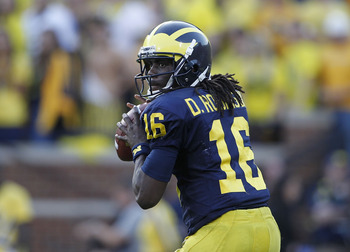ANN ARBOR, MI - OCTOBER 09:  Denard Robinson #16 of the Michigan Wolverines drops back to pass during the game against the Michigan State Spartans on October 9, 2010 at Michigan Stadium in Ann Arbor, Michigan. The Michigan State Spartans defeated the Mich