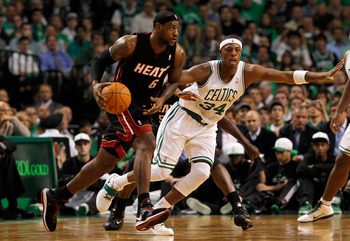 BOSTON, MA - OCTOBER 26:  Paul Pierce #34 of the Boston Celtics defends against LeBron James #6 of the Miami Heat at the TD Banknorth Garden on October 26, 2010 in Boston, Massachusetts. NOTE TO USER: User expressly acknowledges and agrees that, by downlo