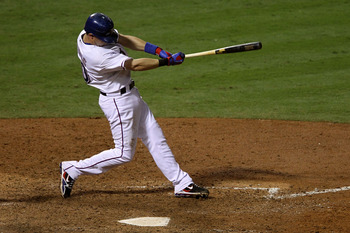 ARLINGTON, TX - OCTOBER 22:  Michael Young #10 of the Texas Rangers hits a double against the New York Yankees in the seventh inning of Game Six of the ALCS during the 2010 MLB Playoffs at Rangers Ballpark in Arlington on October 22, 2010 in Arlington, Te