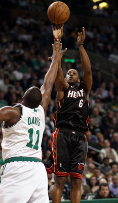 BOSTON - APRIL 27:  Mario Chalmers #6 of the Miami Heat takes a shot as Glen Davis #11 of the Boston Celtics defends during Game Five of the Eastern Conference Quarterfinals of the 2010 NBA playoffs at the TD Garden on April 27, 2010 in Boston, Massachuse