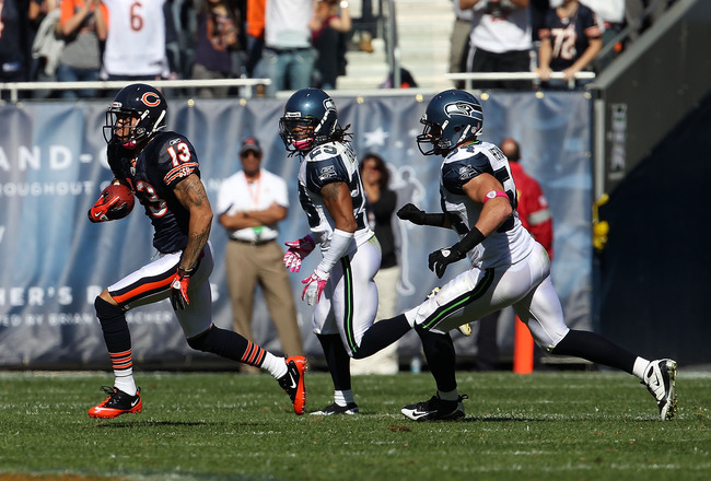 CHICAGO - OCTOBER 17: Johnny Knox #13 of the Chicago Bears runs past Walter Thurmond #28 and Will Herring #54 of the Seattle Seahawks at Soldier Field on October 17, 2010 in Chicago, Illinois. The Seahawks defeated the Bears 23-30. (Photo by Jonathan Dani