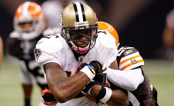 NEW ORLEANS - OCTOBER 24:  Marques Colston #12 of the New Orleans Saints is tackled by Mike Adams #20 of the Cleveland Browns at the Louisiana Superdome on October 24, 2010 in New Orleans, Louisiana.  The Browns defeated the Saints 30-17.  (Photo by Chris