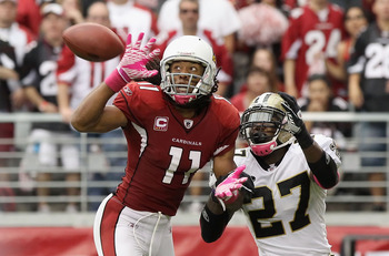 GLENDALE, AZ - OCTOBER 10:  Wide receiver Larry Fitzgerald #11 of the Arizona Cardinals attempts to catch a pass under pressure from Malcolm Jenkins #27 of the New Orleans Saints during the NFL game at the University of Phoenix Stadium on October 10, 2010