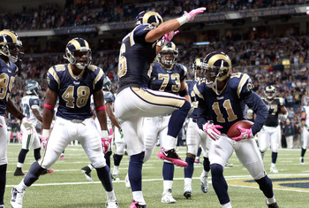 ST. LOUIS - OCTOBER 03: Brandon Gibson #11 of the St. Louis Rams is congratulated by teammates Danny Amendola #16,Fendi Onobun #48 and Adam Goldberg #73 after Gibson scored a touchdown in the first half against the Seattle Seahawks on October 3, 2010 at E
