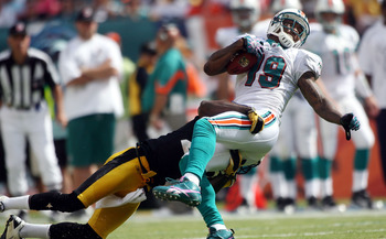 MIAMI - OCTOBER 24:  Receiver Brandon Marshall #19 is brought down by the Pittsburgh Steelers at Sun Life Stadium on October 24, 2010 in Miami, Florida.  (Photo by Marc Serota/Getty Images)
