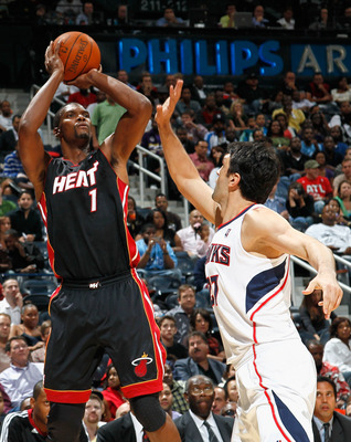 ATLANTA - OCTOBER 21:  Chris Bosh #1 of the Miami Heat shoots over Zaza Pachulia #27 of the Atlanta Hawks at Philips Arena on October 21, 2010 in Atlanta, Georgia.  (Photo by Kevin C. Cox/Getty Images)
