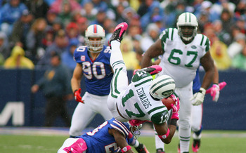 ORCHARD PARK, NY - OCTOBER 03: Braylon Edwards #17 of the New York Jets is upended by Leodis McKelvin #28 of the Buffalo Bills at Ralph Wilson Stadium on October 3, 2010 in Orchard Park, New York. The Jets won 38-14. (Photo by Rick Stewart/Getty Images)