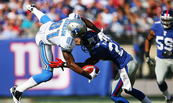 EAST RUTHERFORD, NJ - OCTOBER 17:  Calvin Johnson #81 of the Detroit Lions completes a first down in the second quarter while Corey Webster #23 of the New York Giants tackles him at New Meadowlands Stadium on October 17, 2010 in East Rutherford, New Jerse