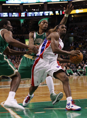 BOSTON - MARCH 15:  Ben Gordon #7 of the Detroit Pistons heads for the net as Marquis Daniels #7 and Michael Finley #40 of the Boston Celtics defend on March 15, 2010 at the TD Garden in Boston, Massachusetts.  NOTE TO USER: User expressly acknowledges an