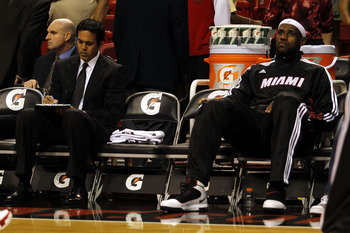 MIAMI - OCTOBER 12:  Forward LeBron James #6 and head coach Erik Spoelstra of the Miami Heat on the bench during a game against CSKA Moskow on October 12, 2010 in Miami, Florida.  NOTE TO USER: User expressly acknowledges and agrees that, by downloading a