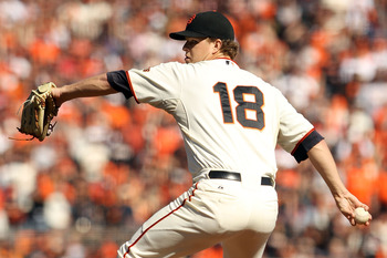 SAN FRANCISCO - OCTOBER 19:  Matt Cain #18 of the San Francisco Giants pitches against the Philadelphia Phillies in Game Three of the NLCS during the 2010 MLB Playoffs at AT&T Park on October 19, 2010 in San Francisco, California.  (Photo by Ezra Shaw/Get