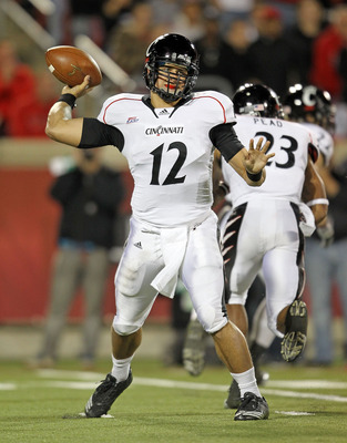 LOUISVILLE, KY - OCTOBER 15:  Zach Collaros #12 of the Cincinnati Bearcats throws a pass during the Big East Conference game against the Louisville Cardinals at Papa John's Cardinal Stadium on October 15, 2010 in Louisville, Kentucky.  (Photo by Andy Lyon
