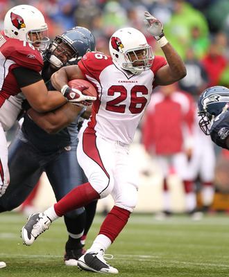 SEATTLE - OCTOBER 24:  Running back Beanie Wells #26 of the Arizona Cardinals rushes against the Seattle Seahawks at Qwest Field on October 24, 2010 in Seattle, Washington. (Photo by Otto Greule Jr/Getty Images)