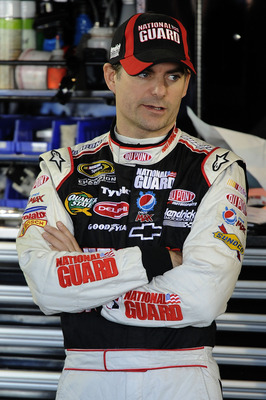 MARTINSVILLE, VA - OCTOBER 23:  Jeff Gordon, driver of the #24 DuPont/National Guard Families Chevrolet, stands in the garage during practice for the NASCAR Sprint Cup Series TUMS Fast Relief 500 at Martinsville Speedway on October 23, 2010 in Martinsvill