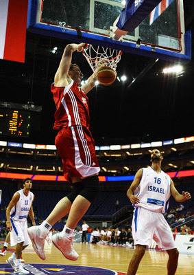 LONDON, ENGLAND - AUGUST 14: Omer Asik of Turkey slam dunks during the game between Turkey and Israel as part of the Game On event at the O2 Arena on August 14, 2009 in London, England.  (Photo by Paul Gilham/Getty Images)