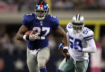 ARLINGTON, TX - OCTOBER 25:  Running back Brandon Jacobs #27 of the New York Giants runs for a touchdown past Brandon Williams #59 of the Dallas Cowboys at Cowboys Stadium on October 25, 2010 in Arlington, Texas.  (Photo by Ronald Martinez/Getty Images)