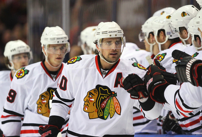 ST. LOUIS - OCTOBER 22: Patrick Sharp #10 of the Chicago Blackhawks is congratulated by teammates after scoring a goal against the St. Louis Blues at the Scottrade Center on October 22, 2010 in St. Louis, Missouri.  (Photo by Dilip Vishwanat/Getty Images)