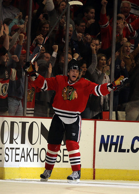 CHICAGO - OCTOBER 18: Marian Hossa #81 of the Chicago Blackhawks celebrates a goal against the St. Louis Blues at the United Center on October 18, 2010 in Chicago, Illinois. The Blackhawks defeated the Blues 3-2 in overtime. (Photo by Jonathan Daniel/Gett